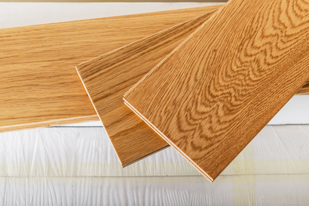 Preparation for house renovation with changing of the floor from carpets to solid oak wood Standard-Bild - 115620310