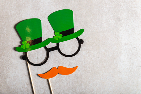 Different photo booth props for St Patricks Day party, top view, grey background