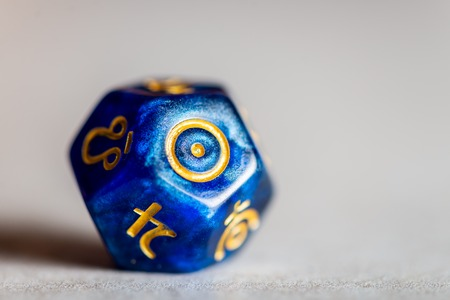 Astrology Dice with symbol of the Sun on grey background