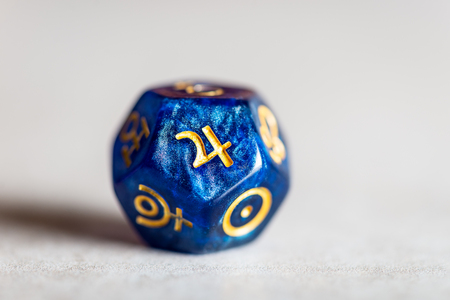 Astrology Dice with symbol of the planet Jupiter on grey background