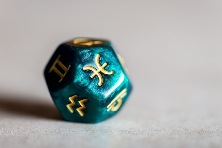 Astrology Dice with zodiac symbol of Pisces