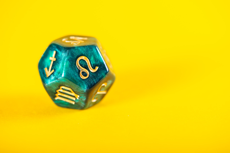 Astrology Dice with zodiac symbol of Leo Jul 23 - Aug 22 on Yellow Background