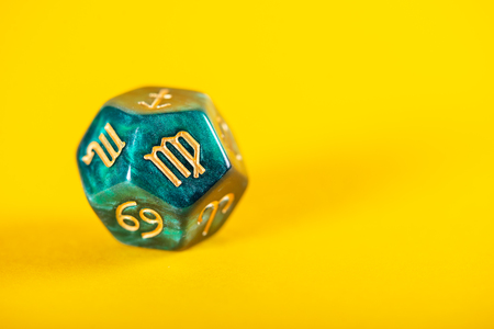 Astrology Dice with zodiac symbol of Virgo Aug 23 - Sep 22 on Yellow Background