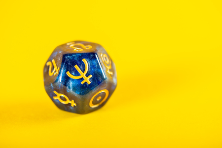 Astrology Dice with symbol of the planet Neptune on Yellow Background