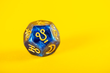 Astrology Dice with symbol of Ketu on Yellow Background