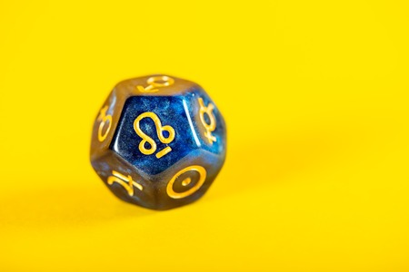 Astrology Dice with symbol of Rahu on Yellow Background