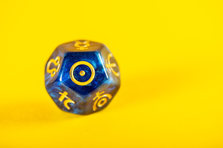 Astrology Dice with symbol of the Sun on Yellow Background Imagens