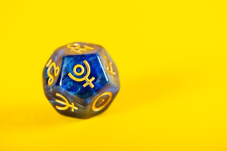 Astrology Dice with symbol of the planet Pluto on Yellow Background