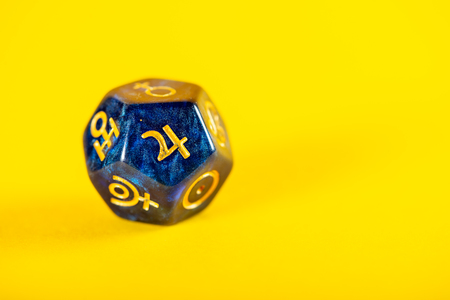 Astrology Dice with symbol of the planet Jupiter on Yellow Background