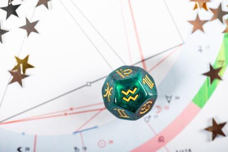 Astrology Dice with zodiac symbol of Aquarius Jan 20 - Feb 18 on Natal Chart Background