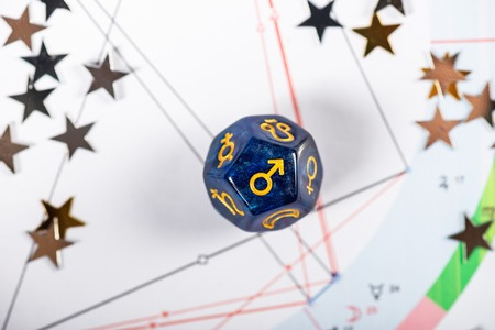 Astrology Dice with symbol of the planet Mars on Natal Chart Background