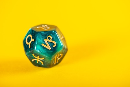 Astrology Dice with zodiac symbol of Capricorn Dec 22 - Jan 19 on Yellow Background Zdjęcie Seryjne