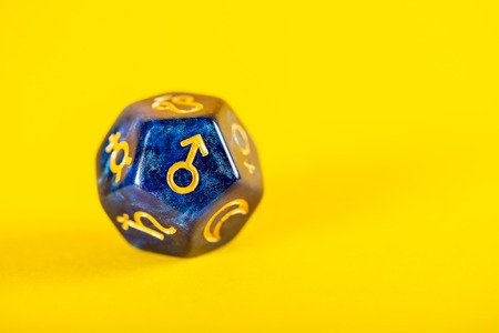Astrology Dice with symbol of the planet Mars on Yellow Background Stock Photo