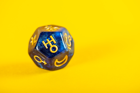 Astrology Dice with symbol of the planet Uranus on Yellow Background
