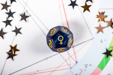 Astrology Dice with symbol of the planet Venus on Natal Chart Background