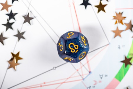 Astrology Dice with symbol of Rahu on Natal Chart Background