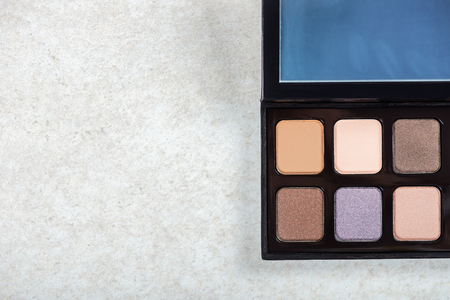 Neutral color eye shadows palette on grey background Stock Photo