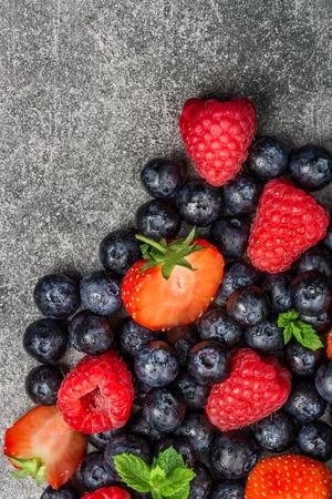 Fresh summer berries such as blueberries, strawberries, raspberries, top view Stock Photo