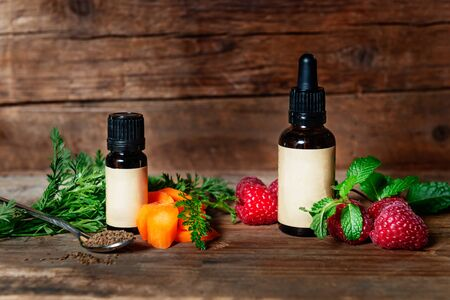 Carrot and Raspberry Seed Oil. Pure, Natural, Cold Pressed, Unscented, Vegan, Hexane Free, No GMO - Ideal for Aromatherapy, Massage Base Oil, or as Sunscreen Stock Photo