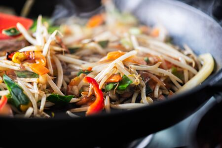 Process of cooking of sweet and crunchy stir fry with beansprouts in the wok, Macro image