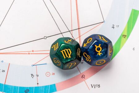 Astrology Dice with zodiac symbol of Virgo Aug 23 - Sep 22 and its ruling planet Mercury Stock Photo