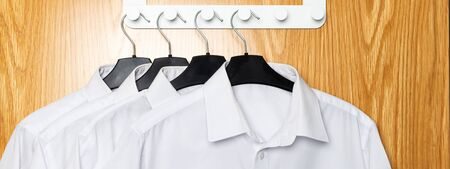 Back to school concept, school uniform such as white shirts hanging on the door