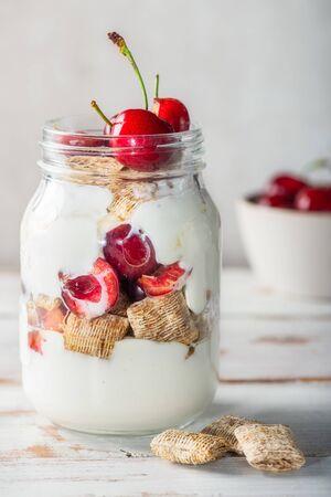 Healthy breakfast in the Jar. Bitesize shredded wheat with fresh cherry berries