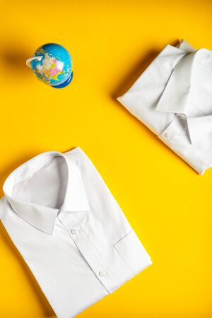 Flat lay with back to school concept, school uniform such as white shirts on bright yellow background Stock fotó - 127270733