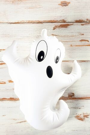 Inflatable white ghost as Halloween party decoration concept, top view, copy space