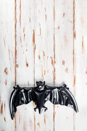Inflatable black bat as Halloween party decoration concept, top view, copy space