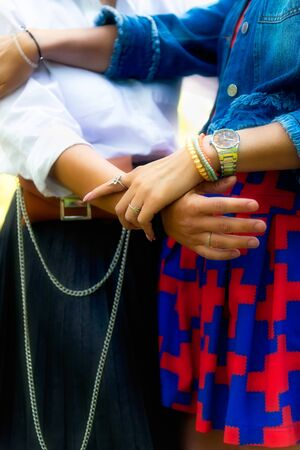 Young female friends are having fun on the green park in the evening, holding hands and hugging each other Stock fotó