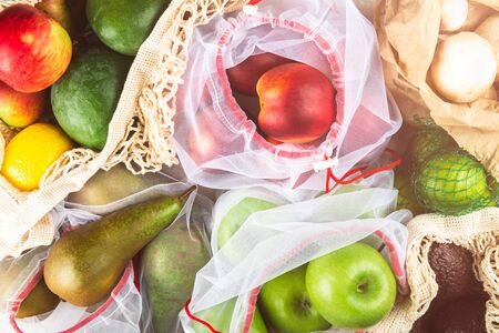 Different Reusable Mesh Bags for Grocery with Fruits and Vegetables, Ecological zero waste and say no to plastic concepts