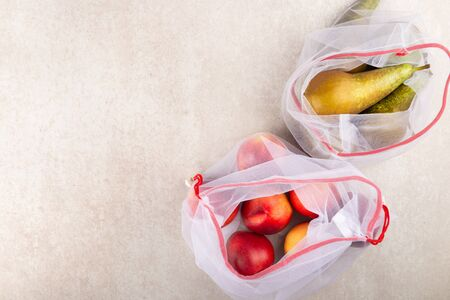 Textile Bags with Fruits and Vegetables, Reusable Shopping Totes for Grocery, Ecological zero waste and say no to plastic concepts
