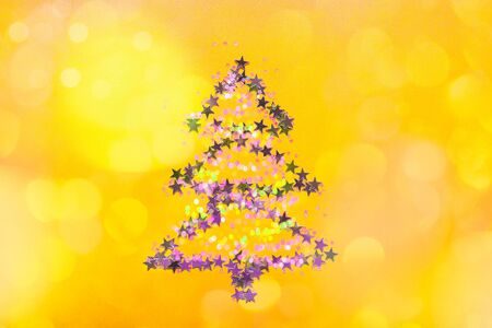 Christmas Tree made from stars on bright yellow background