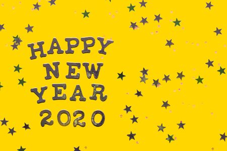 Happy New 2020 Year letters on bright yellow background