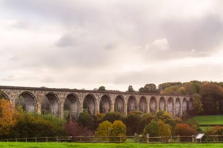 Hidden gem in Wales during Autumn - Ty Mawr Country Park. Trails are running beneath the Cefn Viaduct, past the banks of the River Dee and along the Cefn Heritage Trail, Wales, UK