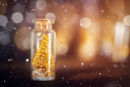 Miniature Gold Christmas Trees in Glass Baubles, which are in the form of Little Bottles, xmas postcard concept
