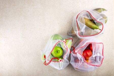 Textile Bags with Fruits and Vegetables, Reusable Shopping Totes for Grocery, Ecological zero waste and say no to plastic concepts Stock Photo