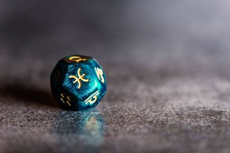 Astrology Dice with zodiac symbol of Pisces Feb 19 - Mar 20 on dark background
