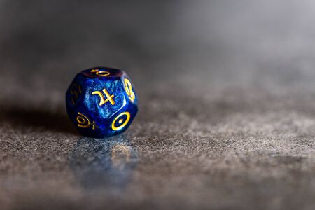 Blue Astrology Dice with symbol of the planet Jupiter on grey background