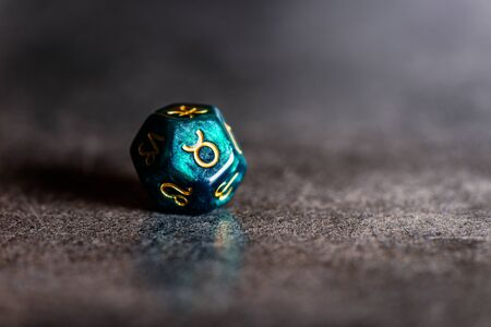 Astrology Dice with zodiac symbol of Taurus Apr 20 - May 20 on dark background