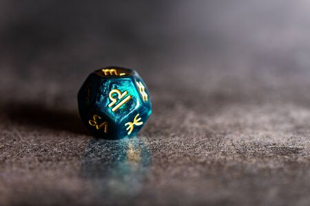 Astrology Dice with zodiac symbol of Libra Sep 23 - Oct 22 on dark background
