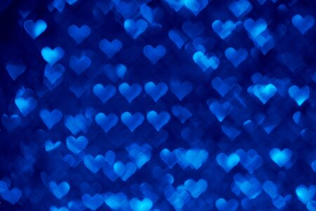 Abstract light, blue bokeh pattern in heart shape. St Valentides Day or Holiday concept, background image. Stock Photo
