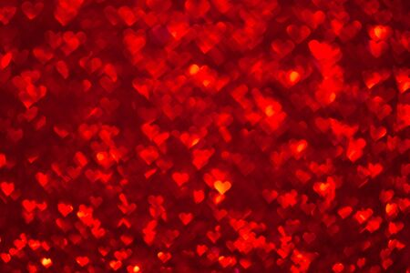 Abstract light, red bokeh pattern in heart shape. St Valentines Day or Holiday concept, background image.