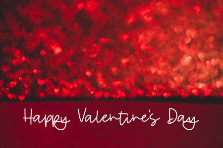 Abstract light, red bokeh pattern in heart shape. St Valentines Day Letters or Holiday concept, background image.