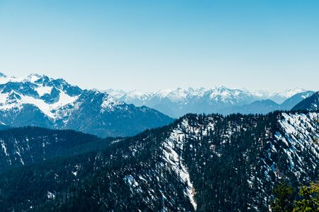 Top Mountain View with snowy peaks from Herzogstand, people can reach it with Herzogstand Cable Car, Bavaria, Germany, late spring vacation