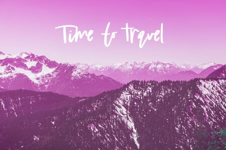 Motivational and inspirational phrase Time to Travel with snowy mountains peaks on the background, toned in purple color