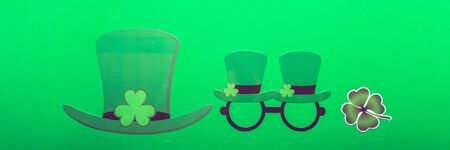 Different photo booth props for St Patricks Day party, top view, green background, banner size