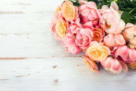 Fresh bunch of pink peonies and roses on wooden rustic background. Card Concept, pastel colors, close up image, copy space Reklamní fotografie