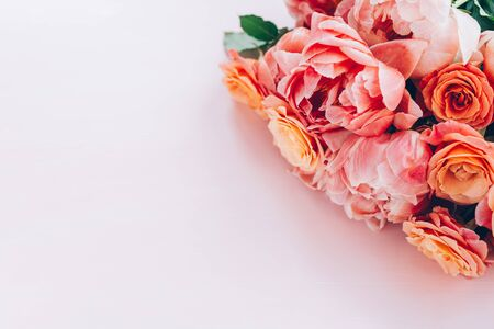 Fresh bunch of pink peonies and roses on pink background. Card Concept, pastel colors, close up image, copy space